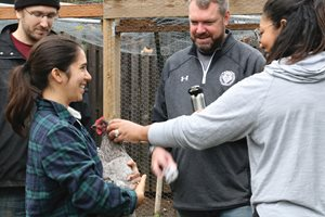 Participants at the Pingry School farm for workshops.